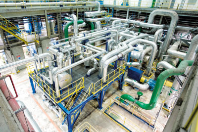 Waste heat recovery for heating demineralised water